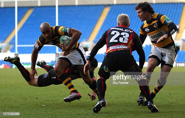 Wasps winger Tom Varndell bursts through to score during the Heineken Cup Round Three match between Newport Gwent Dragons and London Wasps at Cardiff...