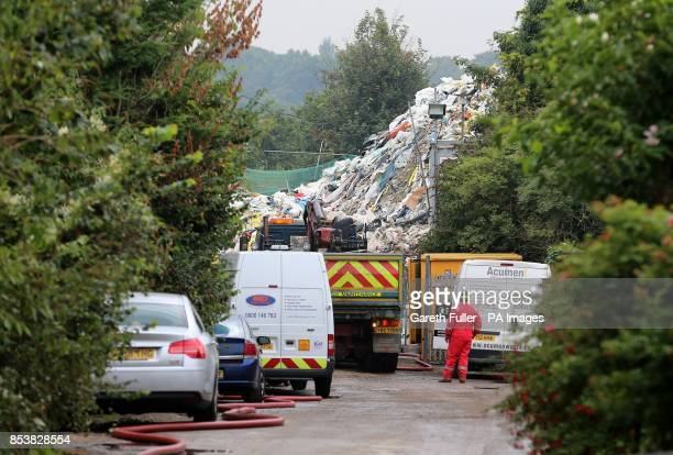 Waste clearance experts work to clear a mountain of rubbish in Cornwall Drive in St Paul's Cray Orpington Kent which has been at the bottom of the...