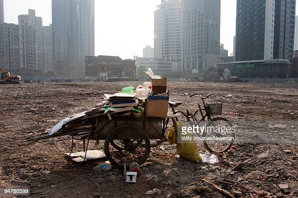 Waste land with skyscrapers in the background, Shanghai, China