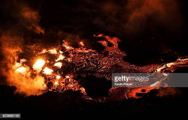 Waste molten steel is seen in a cooling pit at an unauthorized steel factory on November 3 2016 in Inner Mongolia China To meet China's targets to...