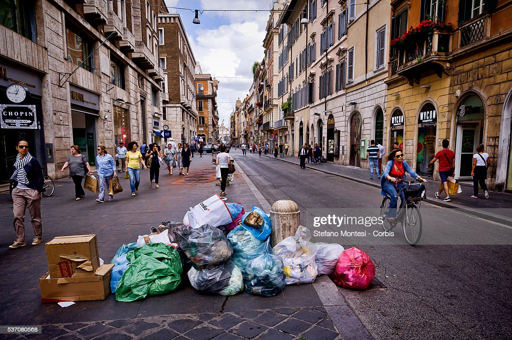 Waste on the Via del Corso in Rome city center during Garbage collectors strike today throughout Italy in support of the dispute for the contract renewal. The workers conducted a protest outside the headquarters of Utilitalia, the association representing the energy and environmental water companies on May 30, 2016 in Rome, Italy. The adherence to the strike was 90% of the 7,800 employees of Ama (Municipal Environment Company Rome) and across Italy where there are about a hundred thousand workers. (Photo by Stefano Montesi/Corbis via Getty Images).