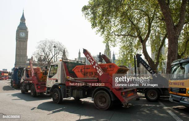 Waste operators driving skip lorries hold up traffic in Parliament Square in central London as they protest over HMRC imposing increases for Landfill...