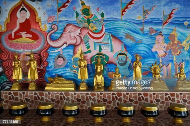 Wat Khao Takiab temple, Hua Hin. Alm bowls, statues and fresco. Thailand.