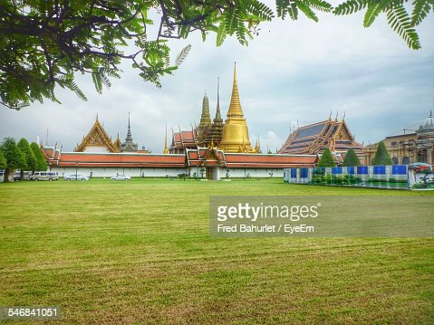 Wat Phra Kaew With Grassy Landscape In Foreground