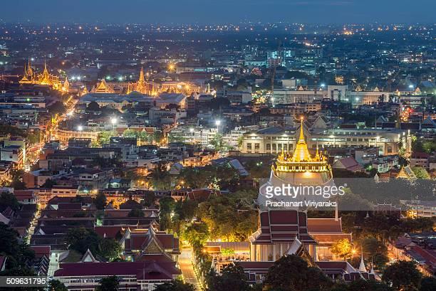 Wat Saket and background is Bangkok Grand Palace