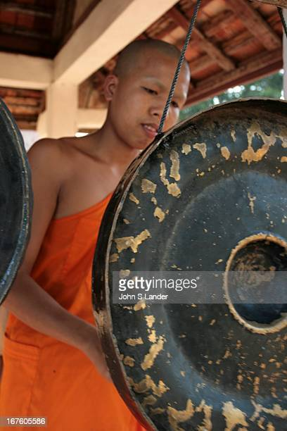 Wat Siphoutthabat banging a gong Buddhism is the primary religion of Laos The Buddhism practiced in Laos is of the Theravada tradition Lao Buddhism...