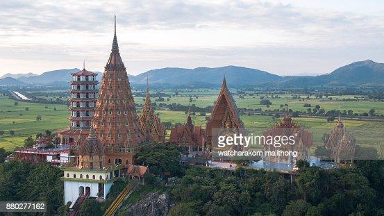 Wat Tham Sua is a public temple in Kanchanaburi, Thailand : Stock Photo