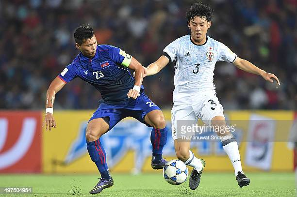 Wataru Endo of Japan and Kouch Sokumpheak of Cambodia competes for the ball during the 2018 FIFA World Cup Qualifier match between Cambodia and Japan...