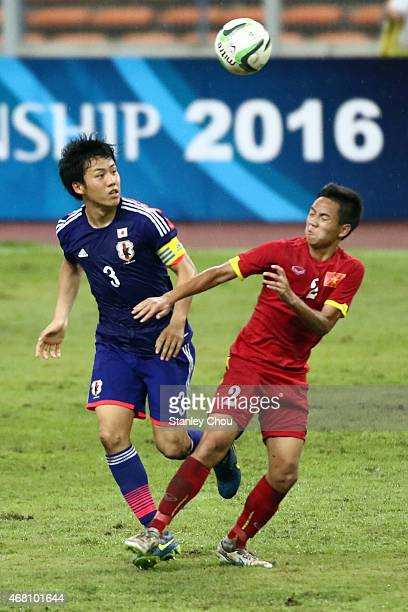 Wataru Endo of Japan battles with Nguyen Manh Hung of Vietnam during the AFC U23 Championship qualifier Group I match between Vietnam and Japan at...