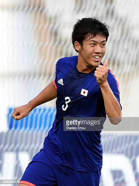 Wataru Endo of Japan celebrates after scoring against Palestine during the Football Mens Round of 16 match between Palestine and Japan during day...