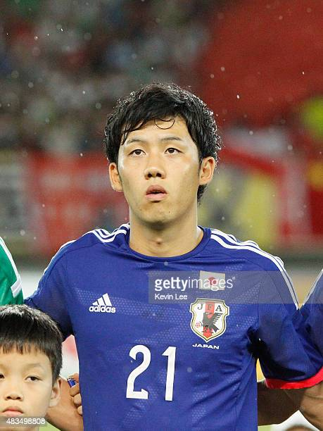 Wataru Endo of Japan stands on the field before the match against China during the EAFF East Asian Cup 2015 final round at the Wuhan Sports Center...