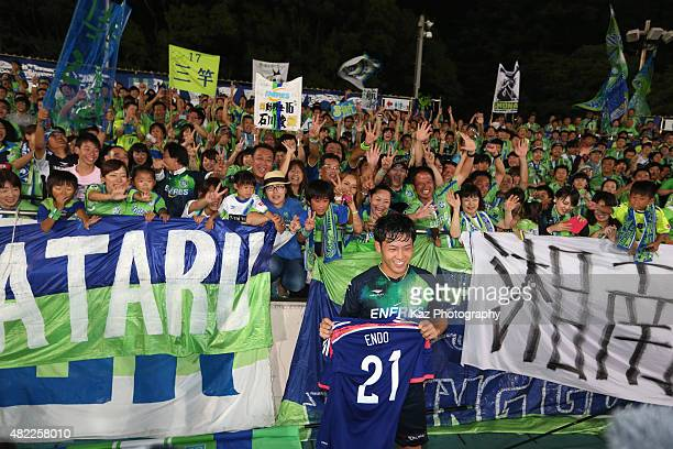 Wataru Endo of Shonan Bellmare is congratulated by supporters on his first callup to the Japan national team after the JLeague match between Shonan...