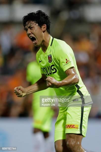Wataru Endo of Urawa Red Diamonds celebrates scoring his side's first goal during the JLeague J1 match between Shimizu SPulse and Urawa Red Diamonds...