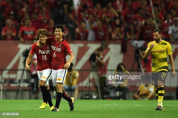 Wataru Endo of Urawa Red Diamonds celebrates scoring his side's second goal during the preseason friendly match between Urawa Red Diamonds and...