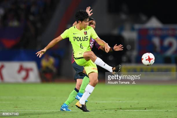 Wataru Endo of Urawa Red Diamonds controls the ball under pressure of Yusuke Tanaka of Ventforet Kofu during the JLeague J1 match between Ventforet...