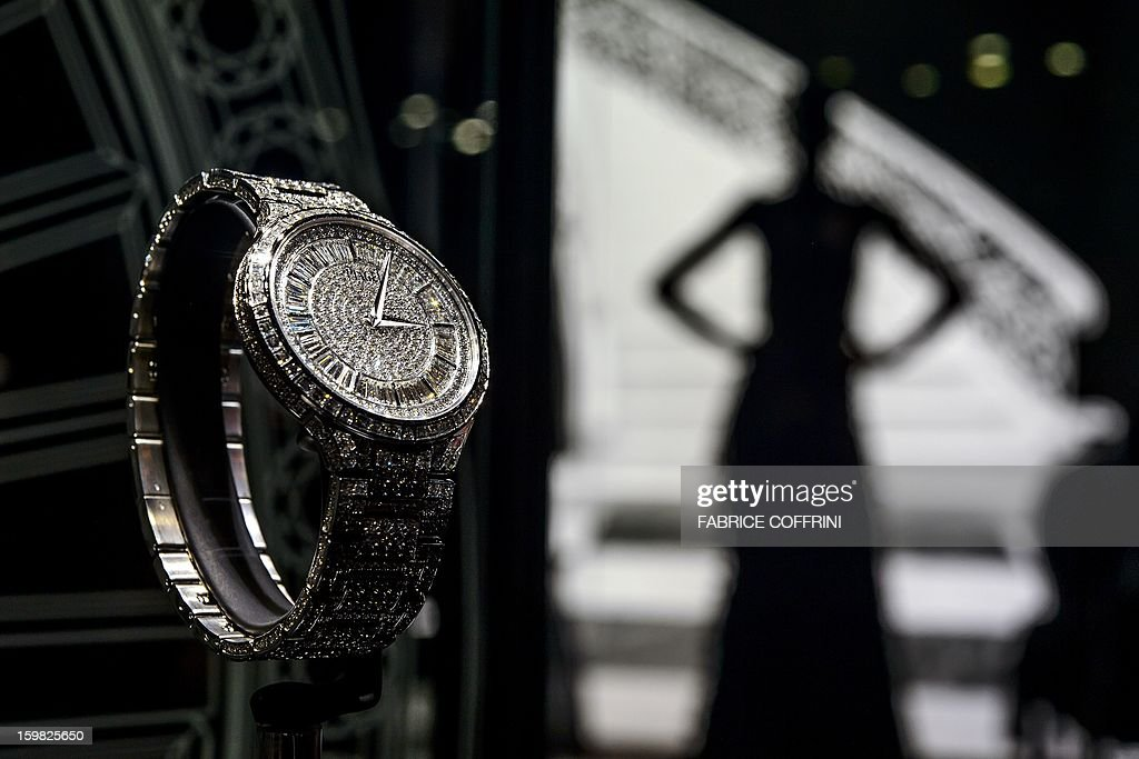 A watch by watchmaker Piaget, part of luxury goods group Richemont, is displayed during the opening day of the 'Salon International de la Haute Horlogerie' (SIHH) a professional fair in fine watchmaking on January 21, 2013 in Geneva. Swiss manufacturer of luxury goods Richemont announced sales meet expectations for the third quarter of its 2012 fiscal year to Euro 2.8 billion.