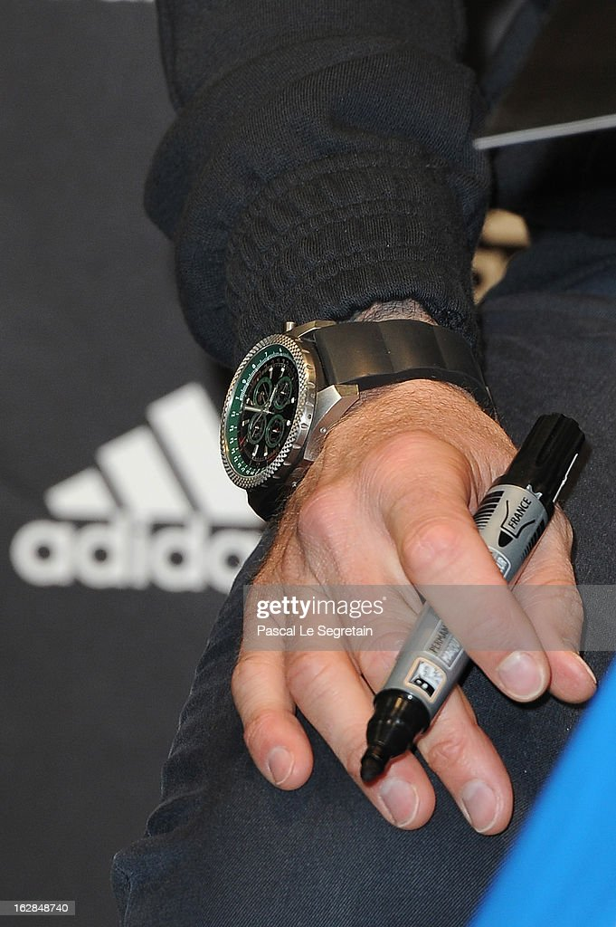 A watch detail of David Beckham as he attends an autograph session at adidas Performance Store Champs-Elysees on February 28, 2013 in Paris, France.