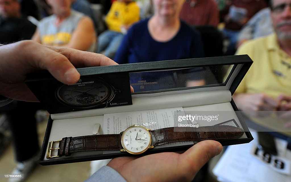 "A watch is displayed for a photograph during an auction of the contents of the corporate offices of Peregrine Financial Group Inc. and My Verona Restaurant as well as personal items to help with the recovery of assets in the Russell Wasendorf Sr. bankruptcy proceedings in Cedar Falls, Iowa, U.S., on Dec. 5, 2012. Wasendorf, the founder of Peregrine Financial Group Inc., pleaded guilty in September to forging statements from lenders ""to embezzle millions of dollars from customer accounts."" Photographer: Steve Pope/Bloomberg via Getty Images"