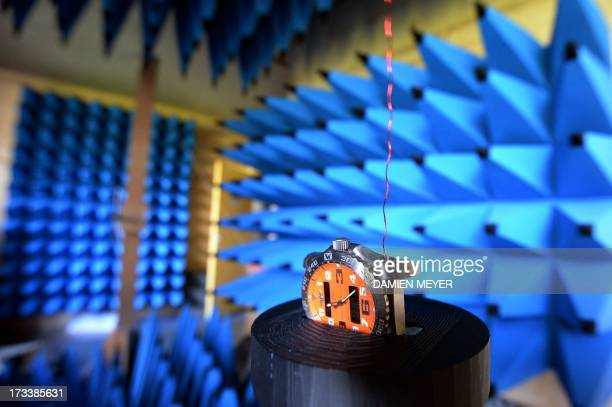 A watch is tested in an anechoic chamber on july 10 2013 at Syrlinks enterprise in Bruz suburb of the western city of RennesThis watch features a...