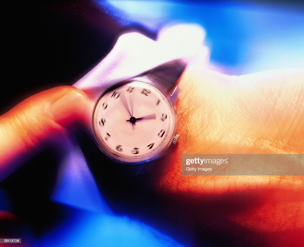 Watch on Businessman's Wrist, Blurred Motion : Stock Photo