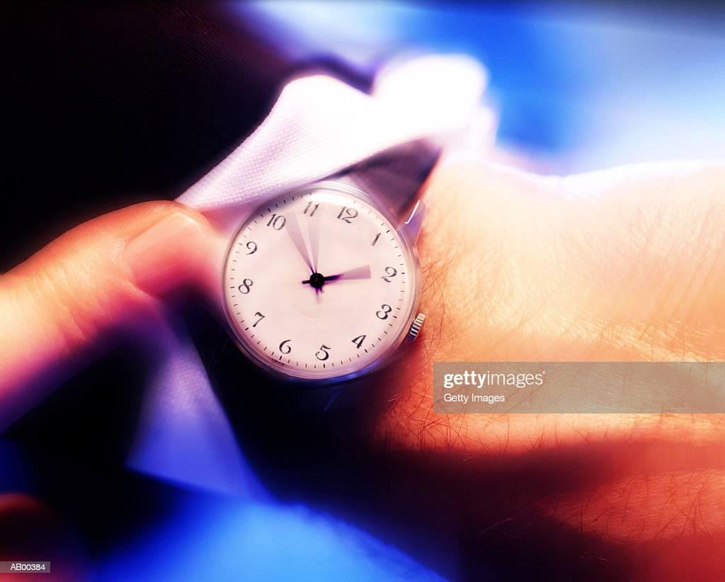 Watch on businessman's wrist (blurred motion) : Stock Photo