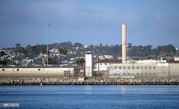 Watch towers of Federal Correctional Institution Terminal Island a low security facility housing male inmates stand at the entrance of the Port of...