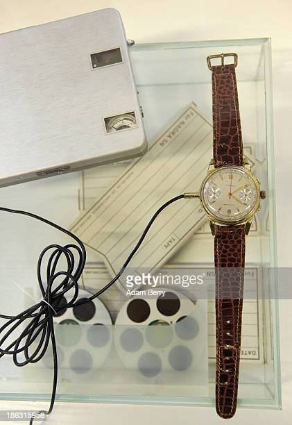A watch used as a microphone connected to a recorder produced in Switzerland in the 1960s by the NAGRA company is displayed at the Stasi or East...