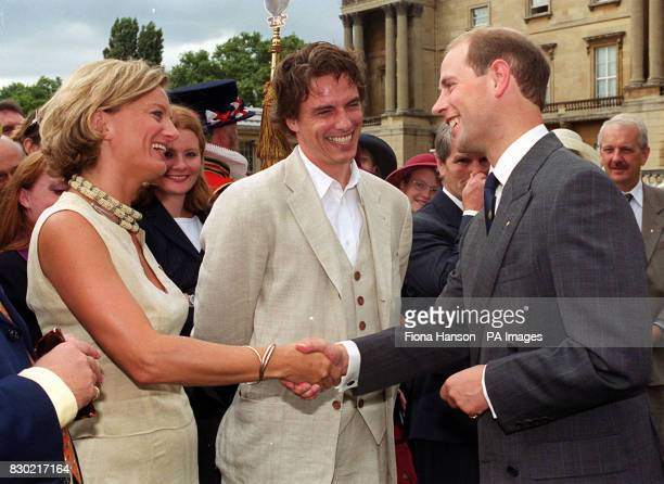 Watchdog presenter Alice Beer and John Barrowman meet the Earl of Wessex during a garden party hosted by the Duke of Edinburgh's at Buckingham Palace
