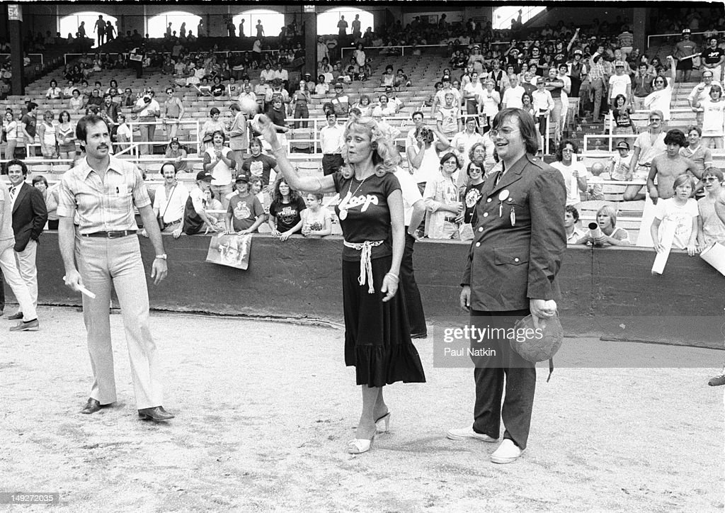 Watched by American disc jockey Steve Dahl model Lorelei Shark throws out a baseball during an antidisco promotion at Comiskey Park Chicago Illinois...