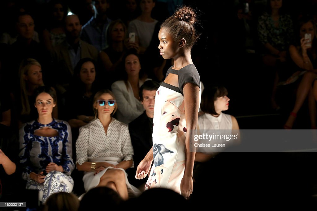 LOOK #13 watched on the runway by model Nicole Trunfio (L) and Olivia Palermo (C) at the Bibhu Mohapatra fashion show during Mercedes-Benz Fashion Week Spring 2014 in the Studio at Lincoln Center on September 11, 2013 in New York City.
