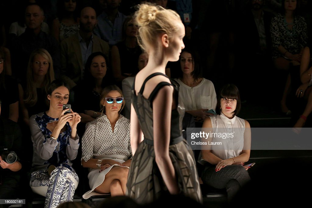 LOOK #18 watched on the runway by model Nicole Trunfio (L) and Olivia Palermo (C) at the Bibhu Mohapatra fashion show during Mercedes-Benz Fashion Week Spring 2014 in the Studio at Lincoln Center on September 11, 2013 in New York City.