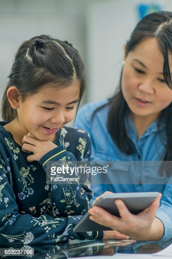 Watching a Video on a Digital Tablet : Stock Photo