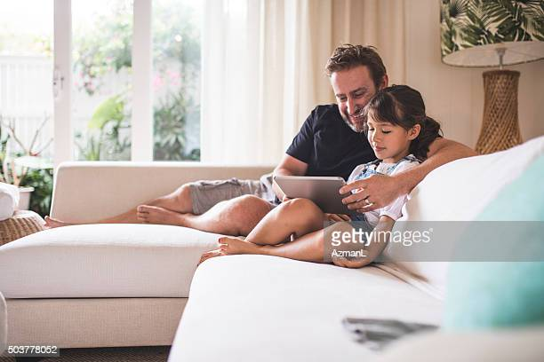Watching funny videos with her dad
