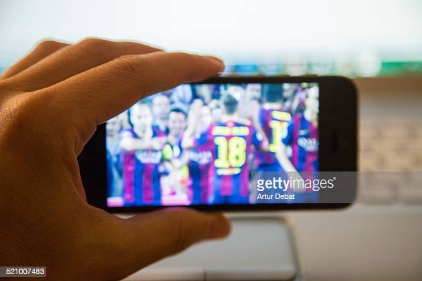 Watching online European football league with iPhone 5s smartphone