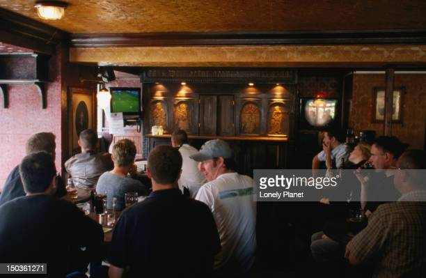 Watching soccer on television at O'Reilly's bar.