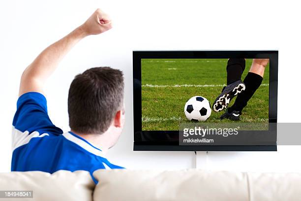 Watching soccer on tv from the sofa