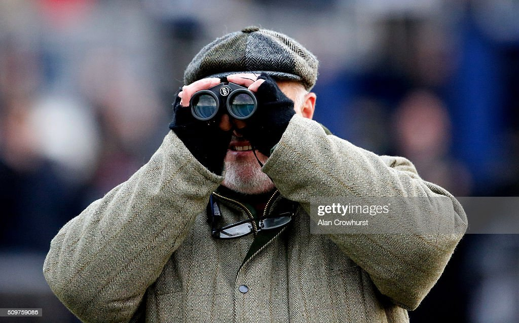 Watching the action at Kempton Park racecourse on February 12, 2016 in Sunbury, England.