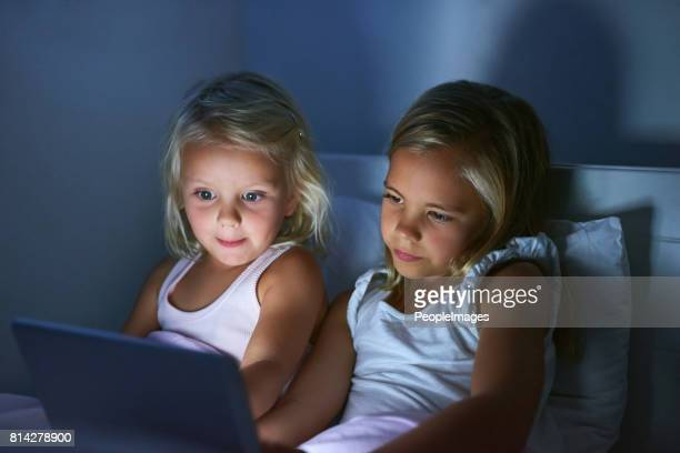 Watching their favourite cartoon before bedtime