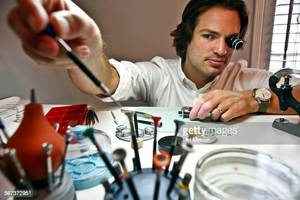 Watchmaker Cameron Weiss reaches for a screwdriver while assembling a watch at his work bench located inside of his apartment in Beverly Hills on...