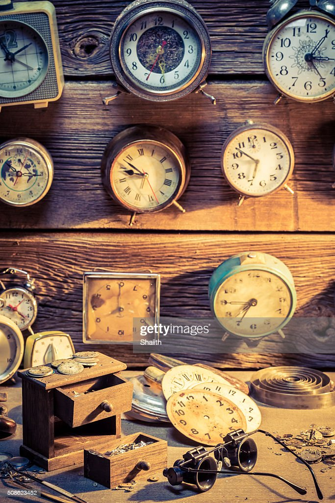 Watchmaker's room with damaged clocks : Stock Photo