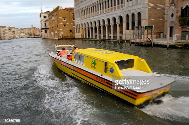 Water ambulance navigating the Canale Grande, Grand Canal Venice, Venetia, Italy