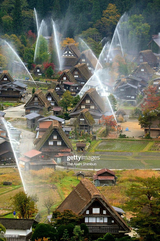 Water are discharged at Shirakawa-go World Heritage site of on November 4, 2012 in Shirakawa, Gifu, Japan. This annual drill is held to prevent fire.