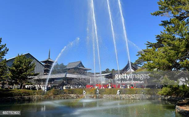 Water are discharged during an annual fire drill at Horyuji Temple on January 26 2017 in Ikaruga Nara Japan The annual drill is held on the Cultural...