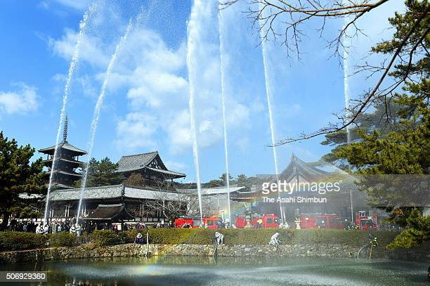 Water are discharged during the annula fire drill at Horyuji Temple on January 26 2016 in Ikaruga Nara Japan The annual drill is held on the Cultural...