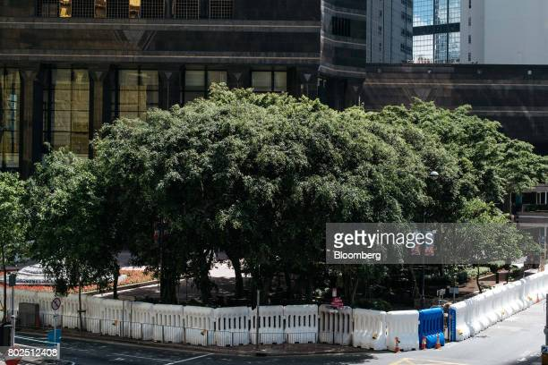 Water barricades are erected near the Hong Kong Convention and Exhibition Center ahead of Chinese President Xi Jinping's arrival in Hong Kong China...