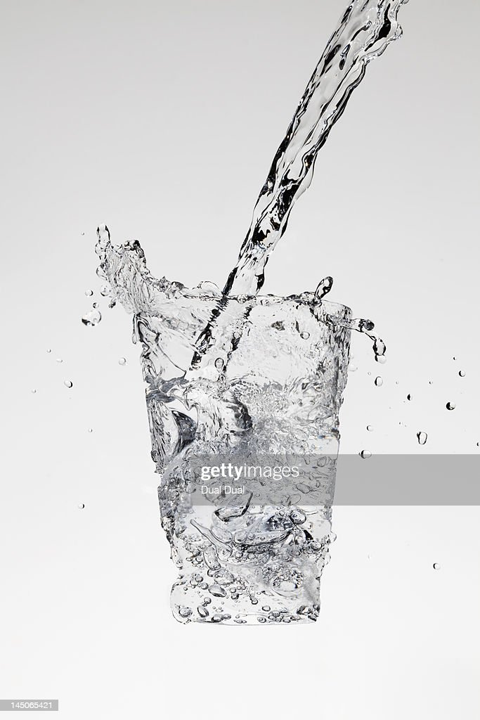 Water being poured in the form of a glass