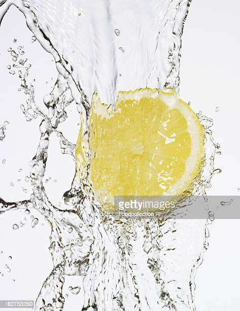 Water being poured on half lemon