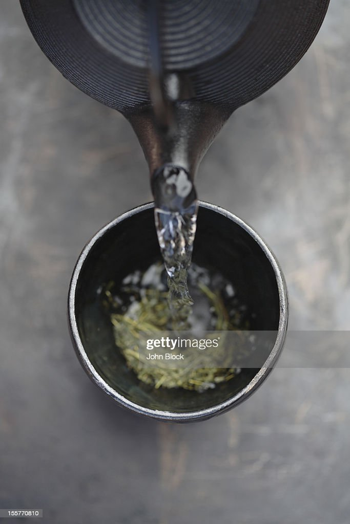 Water being poured on tea leaves