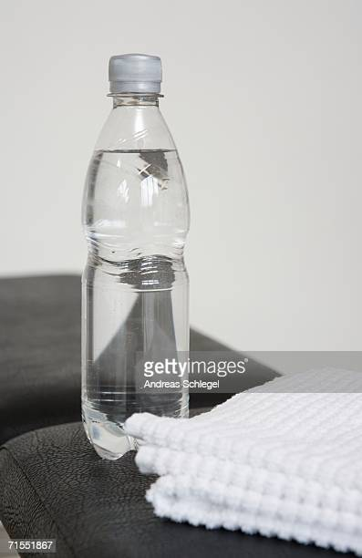 Water bottle and towel in a gym