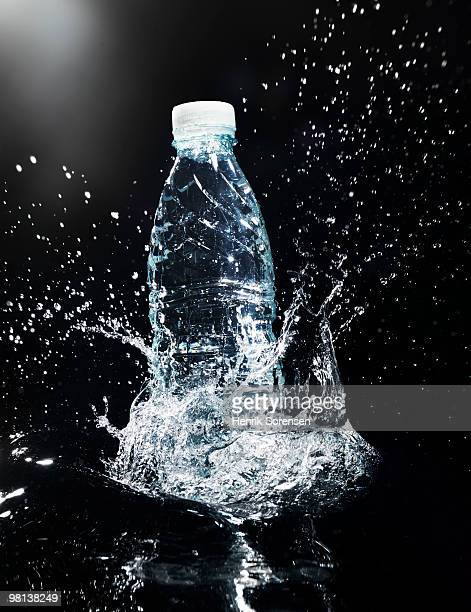 Water bottle in splashing water